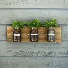 Wall Hanging Planters by 12 Fence Planters That U0027ll Have You Enjoying Your Private Garden
