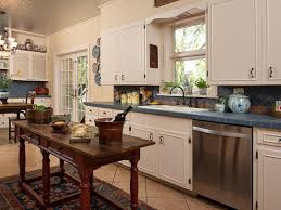 Kitchen With An Island by Tile Floor Stainless Steel Appliances White Walls Small Kitchen