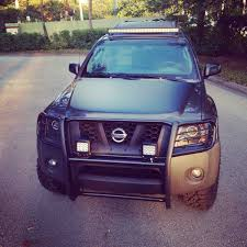 nissan xterra front bumper new spot lights on the brush guard and hood blackout to cut down