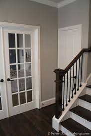 love this color combo dark wood flooring and railing with
