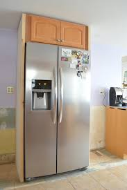 how to build a cabinet around a refrigerator surrounding the fridge plaster disaster