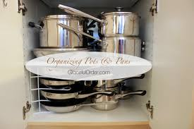 how to organize pots and pans in a cupboard organizing pots and pans graceful order