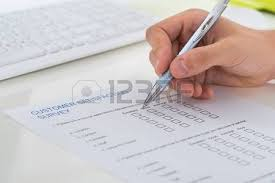 Research Survey Images  amp  Stock Pictures  Royalty Free Research     research survey  Close up Of Person Hands Filling Survey Form With Pen Stock Photo