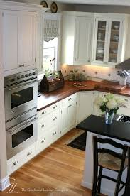 kitchen with white cabinets and wood countertops 13 diy butcher block countertops ideas butcher block