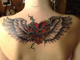 collection of 25 with wings tattoos on neck