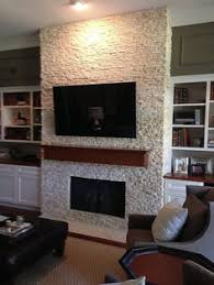 Fireplace Wall Tile by A Stunning Sandstone Tile Fireplace Surround Stretches All The Way