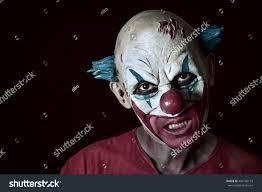 halloween portrait background portrait scary evil clown against dark stock photo 490136173