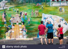 100 painted murals on walls hand painted murals promotion painted murals on walls people looking at art murals painted on outdoor building walls in