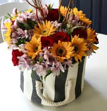 the yellow cape cod high impact 5 minute fall centerpiece in a