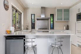 kitchen style white cabinetry glass cabinet doors beach kitchen