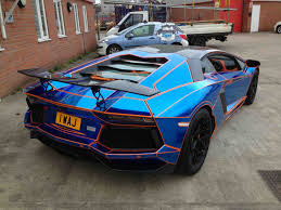 red chrome lamborghini blue chrome tron style wrap by premier signs to orange oakley