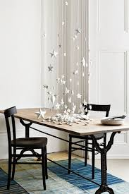 hanging stars from ceiling christmas table houseandgarden co uk