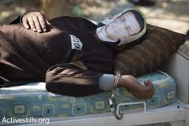 handcuffed to bed palestinian hunger striker to remain handcuffed to hospital bed