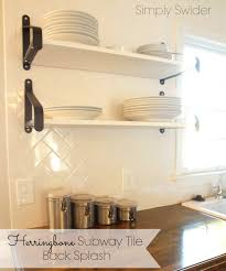 kitchen subway tile back splash in a herringbone pattern simply