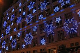 saks fifth avenue lights saks 5th ave snowflake spectacular focus lighting architectural
