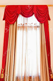 red long drapery at big bright window stock photo picture and