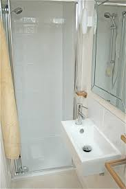 very small bathroom arragement idea with narrow shower and white