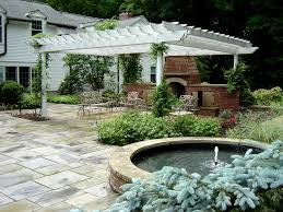 traditional patio with exterior stone floors by the pattie group