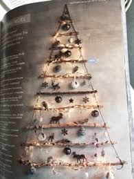 tree made from recycled sticks its a space saver and