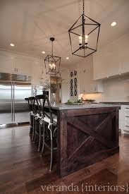 white kitchen island granite top white cabinets stained island granite top iron lanterns