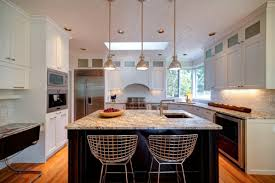 beautiful black rectangular pendants in a white kitchen with