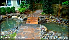 goldfish pond and bridge designed and installed by full service