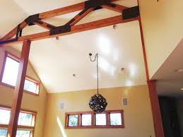 ideas sloped ceiling with dark wine barrel chandelier and faux