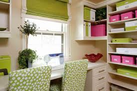 home office with tv spacious craft room and home office with integrated workspace and