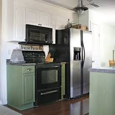 gray kitchen cabinets with black appliances home living green kitchen with black appliances