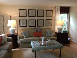 wall behind the couch 16x16 frames with linen matting from