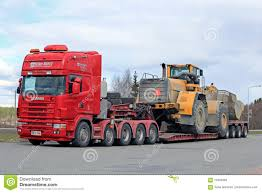 volvo long haul trucks scania 164g semi truck heavy wheel loader transport editorial