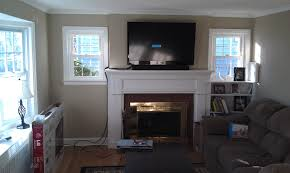 white wooden fireplace mantle shelf as wall mount tv stand as well