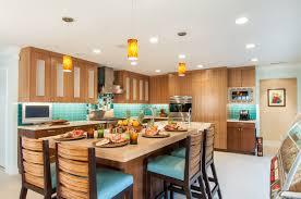 modern kitchen with custom backsplash red door living