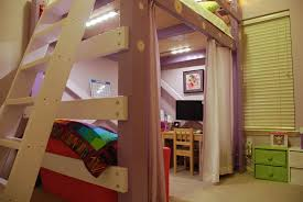 a u0027s loft bed with ladder and lighted workspace underneath