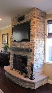 dark wood coffee table real stone tv over fireplace two story
