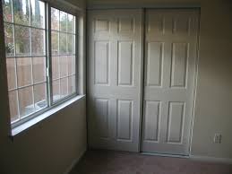 Wood Sliding Closet Door White Wood Sliding Closet Door Buzzardfilm Installing Wood