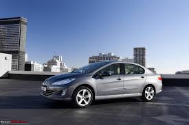 peugeot world peugeot unveils the new 408 at its world premier in beijing team bhp