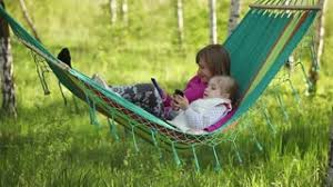 young woman in hammock in forest outdoor recreation spring