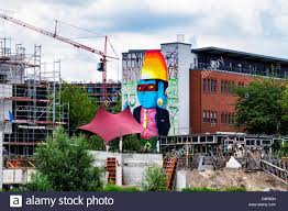 martini giant berlin mitte giant mural street art man with blue face mask