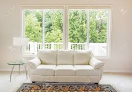 How To Clean White Leather Sofa Clean Family Room With White Leather And Large Windows
