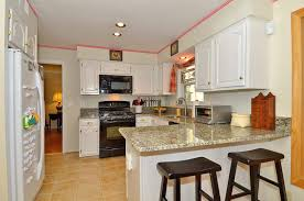 kitchen white cabinets black appliances perfect home design