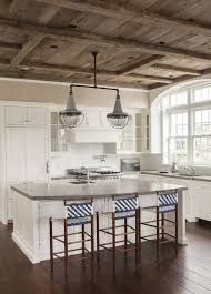 gray reclaimed wood kitchen island with farmhouse sink cottage