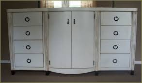 moveable distressed white kitchen cabinets under windw curtains