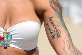 tattoos at the u s open of surfing beachgoers explain what their