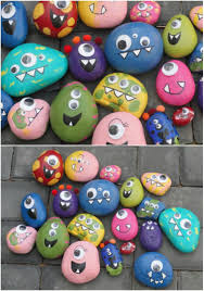these happy monster rocks would brighten up any garden cute diy