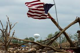 Ripped American Flag File An American Flag Flies Amid Debris And Wreckage In Moore