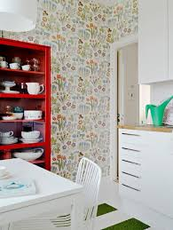 small kitchen furnished with white and red furniture and decorated