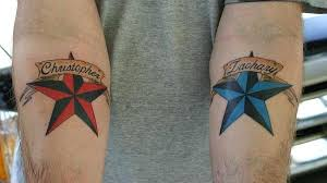 red nautical star tattoo on elbow photo 3 2017 real photo