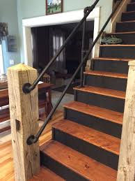 reclaimed barn timber used as newel post w galvanized pipe