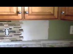 how to install a mosaic tile backsplash in the kitchen how to install a glass mosaic tile backsplash parts 1 2 and 3